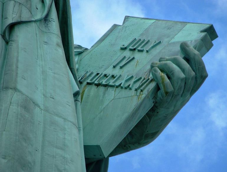The tablet in the left hand of the Statue of Liberty