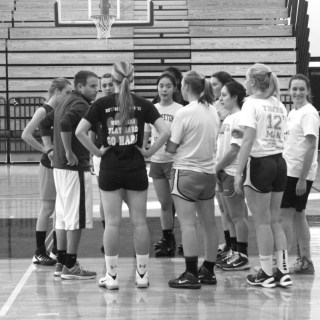 The girls basketball team listens to instructions from new Head Coach Dan Van Hise during practice. photo by Shreya Dandamudi
