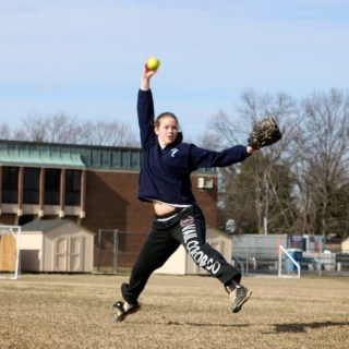 Sarah Eisenach '15 practices pitching at a softball practice at John Witherspoon Middle School. photo: Rhea Braun