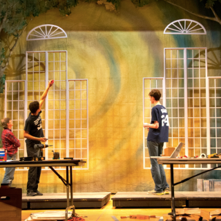 Membersof Spectacle Theatre work on the set for the show. photo: Aaron Olkin