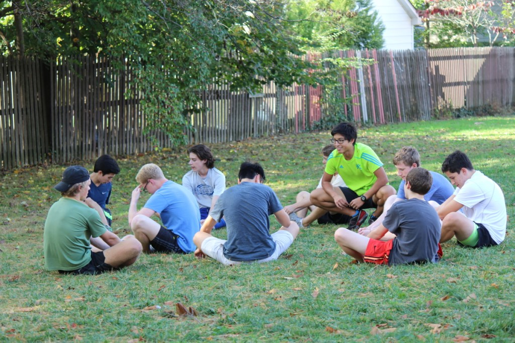 Members of the boys corss country team stretch before practice on October 16. Alex Roth '17 and James Cao '15 missed the beginning of the season due to injury and paperwork issues, respectively. photo: Shreya Dandamudi