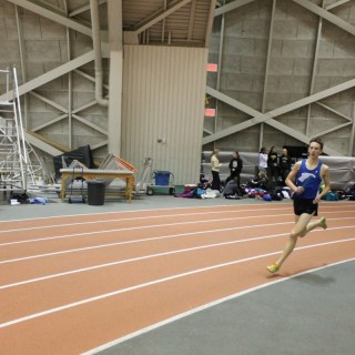 Alex Roth '17 competes in the 4x800m relay at the first Jadwin meet on January 14 at Princeton University's Jadwin Gymnasium. The 4x800m relay team finished first out of five teams. Photo: Jennifer Miller