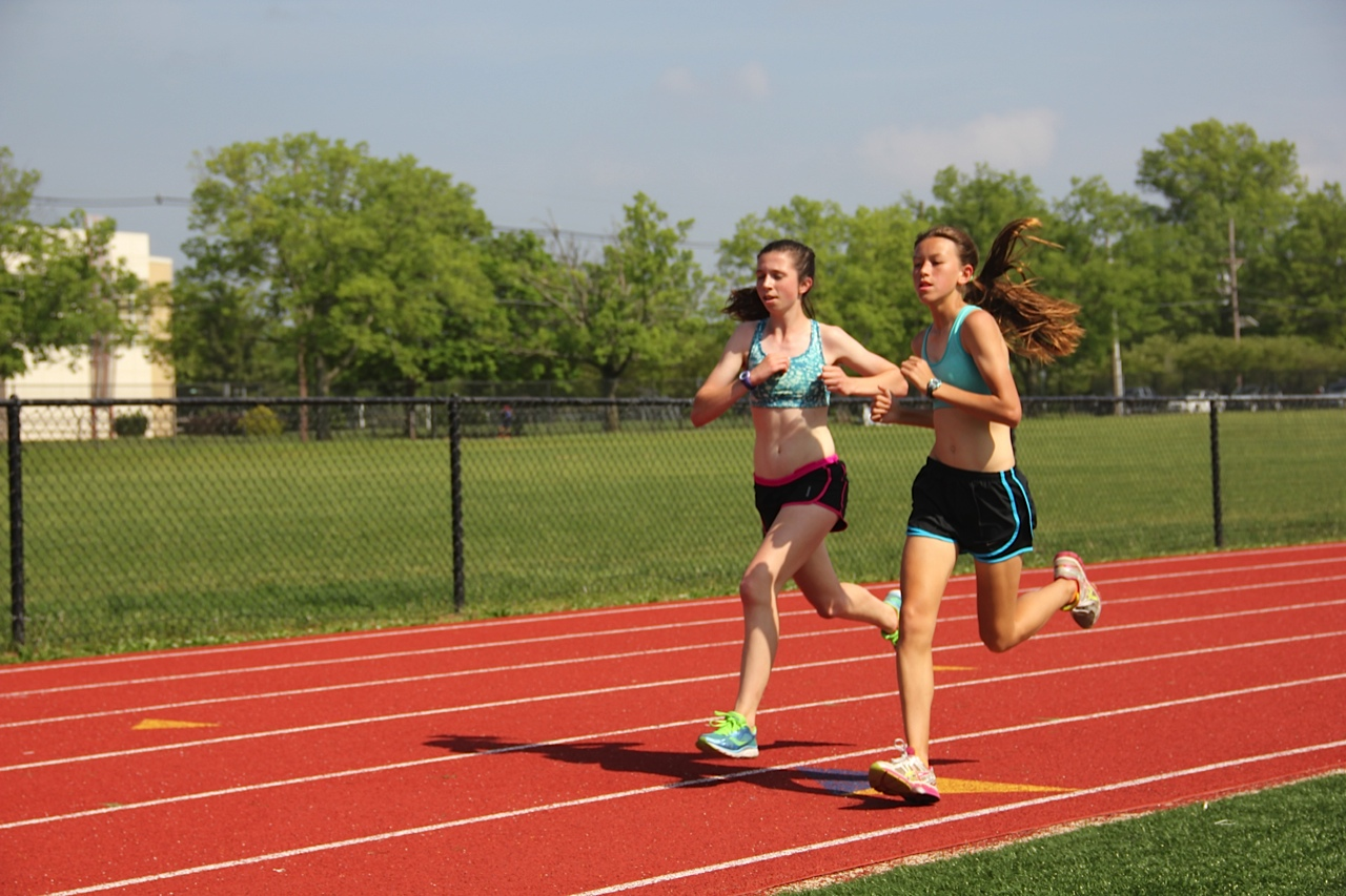 Izzy Trenholm '17 and Chloe Taylor '18 run during practice. Taylor qualified for Freshman Nationals in the 3200 meter.  Photo: Amy Wang