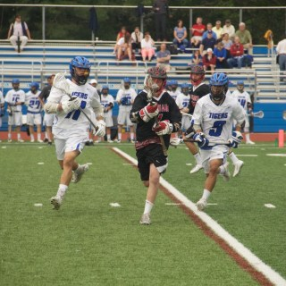 Rory Helstrom '16 (#15, left) and Mark Duarte '17 (#9, right) defend against Jackson Memorial High School on May 16 at the PHS turf.
