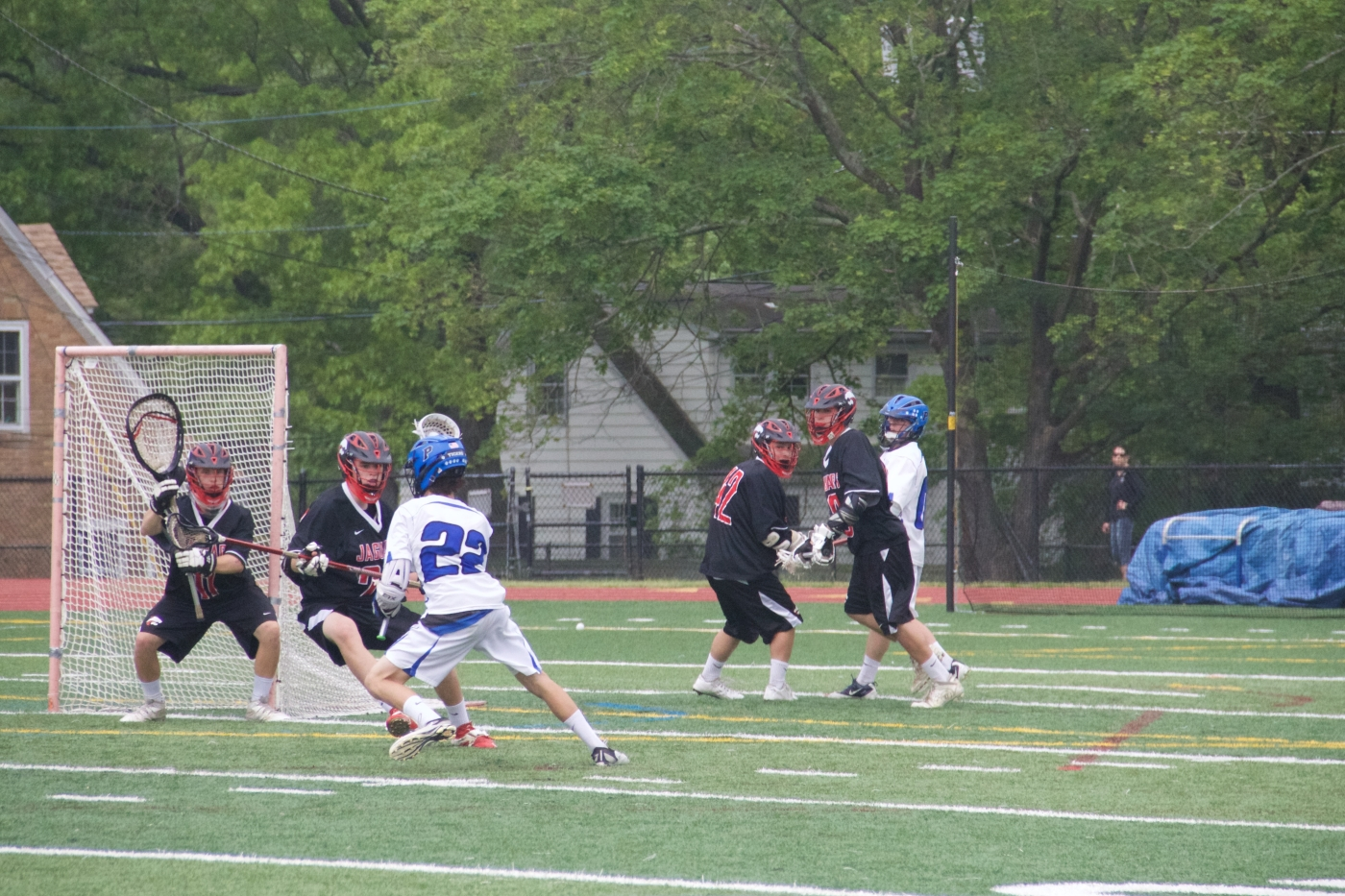 Johnny Lopez-Ona '17 (#22) sets an offensive play against Jackson Memorial High School on May 16. The Little Tigers won 14–0. Photos: Caroline Smith