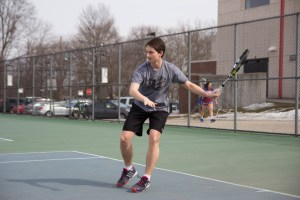 Tyler Hack '15 returns a volley during practice on March 15. photo: Nathan Drezner