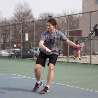 "Tyler Hack '15 returns a volley during practice on March 15. photo: [credit name=""Nathan Drezner"" position="""" type=""visual""]"