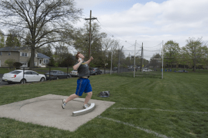 "Paul Brennan '19 throws the shotput during a practice on April 20. He is the defending Mercer County champion in this event. photo by <span class=""credit credit- ""><a href=""/credit/""Aaron/"" title=""View all of this person's work"">""Aaron</a></span>"