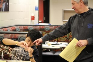 """photo by <span class=""""credit credit- """"><a href=""""/credit/""""Brian/"""" title=""""View all of this person's work"""">""""Brian</a></span> Physics teacher Mark Higgins and Eddie Cai '17 work on a tower constructed with balsa wood at the NJ Science Olympiad Union County College Regional Event."""