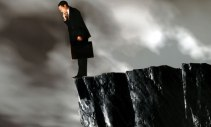 A businessman on a cliff