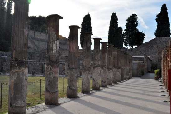 Columns casting shadows in Pompeii