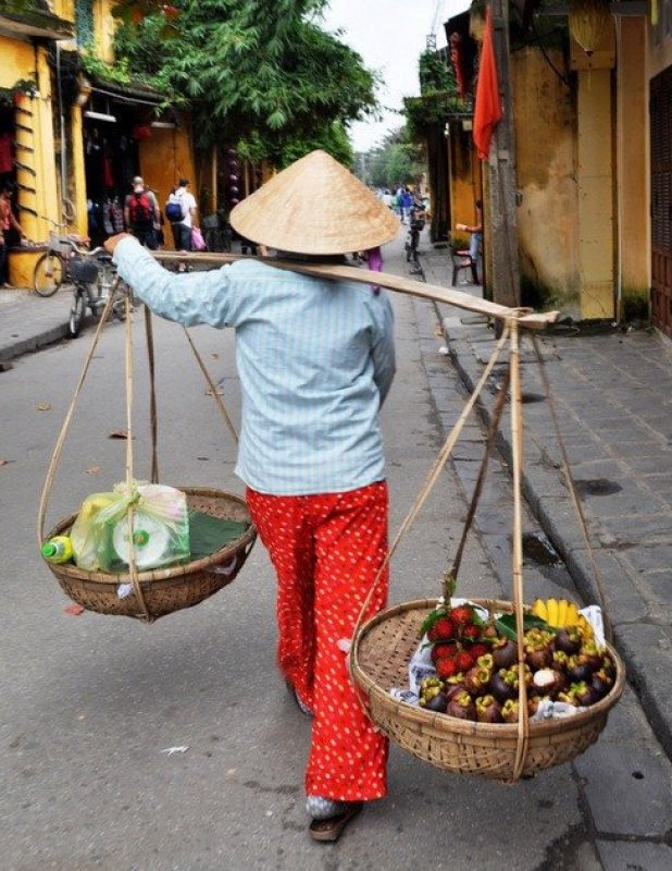 vietnamese woman with baskets