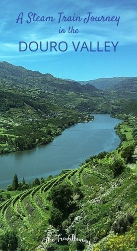 A vintage steam train journey through the Douro Valley vine region in Portugal