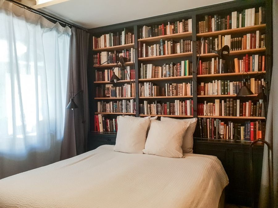 Bed with bookshelf behind