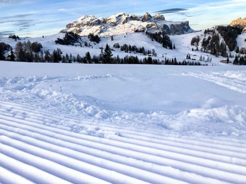 Groomed piste with mountain backdrop