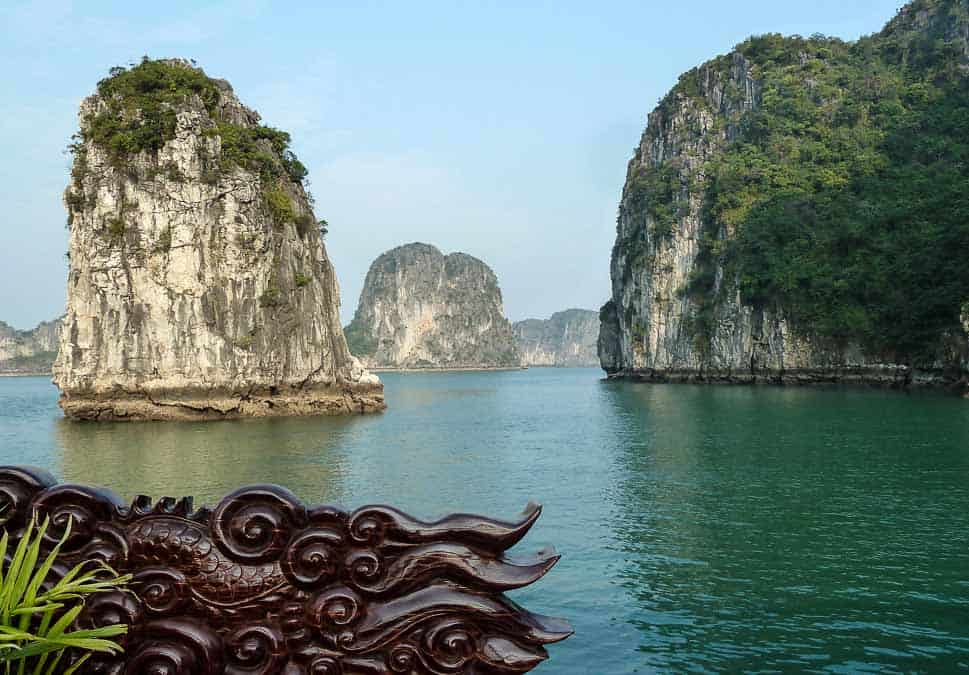 Halong Bay Karsts and carved wooden boat