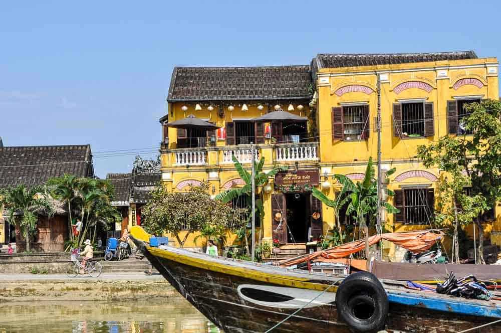Yellow houses and boats on the Thu Bon River, Hoi An