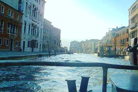 Taking a ferry through the canals is a great way of visiting Venice on a budget