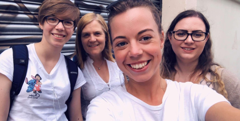 Four women take a selfie outside the Secret Studio Escape Room in London.