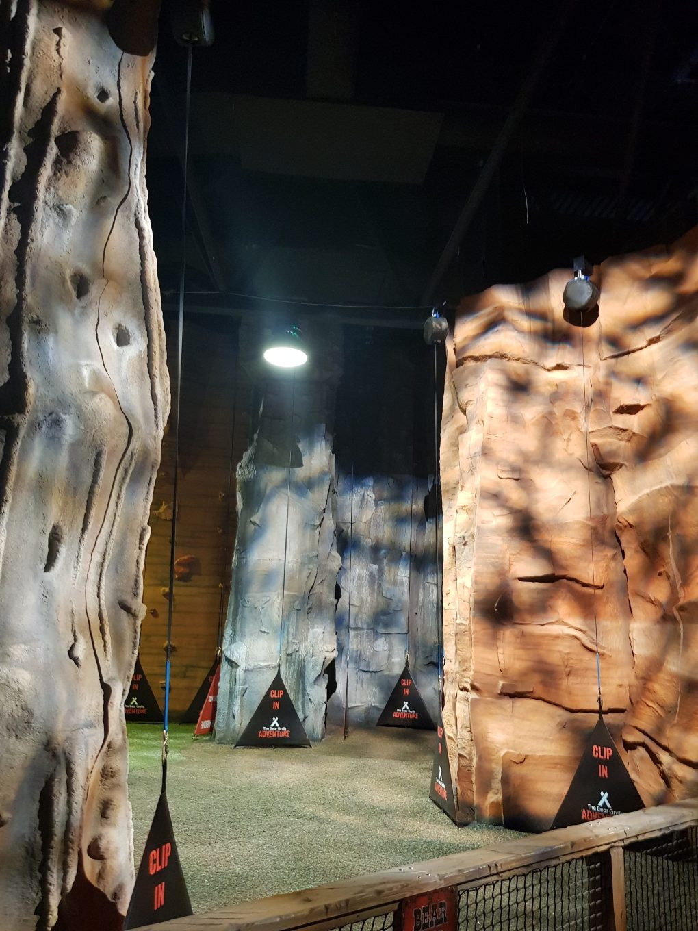 Adrenaline Rush Activities. Some of the more difficult climbing walls designed to look like real rock faces with bumbs and ridges in brown and grey colours.