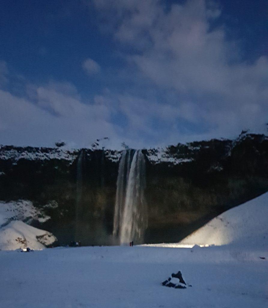 Seljalandsfoss waterfall in the evening as it is getting dark