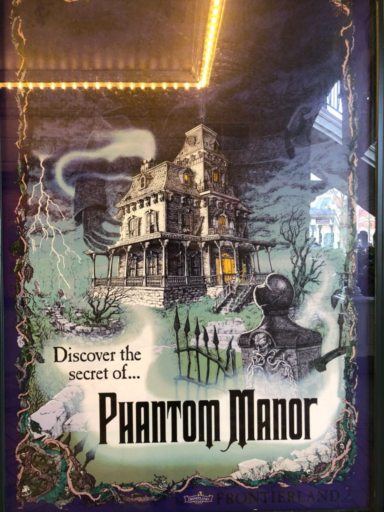 Vintage poster of Phantom Manor with a picture of a spooky looking manor house
