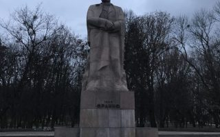 statue of an older man in a park in L'viv, Ukraine
