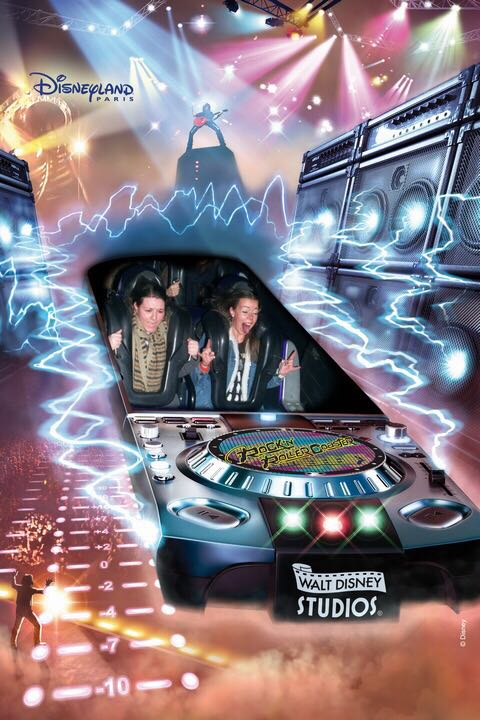 A ride photo of two girls taken on the Rock 'n' Roller ride at Disneyland Paris. Two girls are in a roller caaster cart with lights and lightning in the background