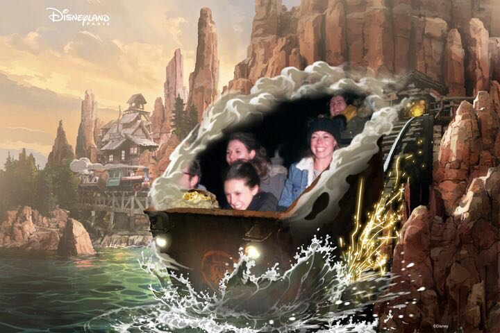 A ride photo from on the Big Thunder Mountain ride at Disneyland Paris. Two girls are in a mine cart styled rollar coaster cart