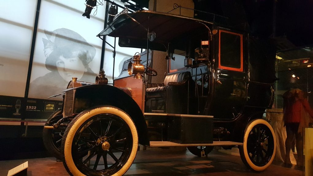 Black open sided car with white tires in the Museum of London