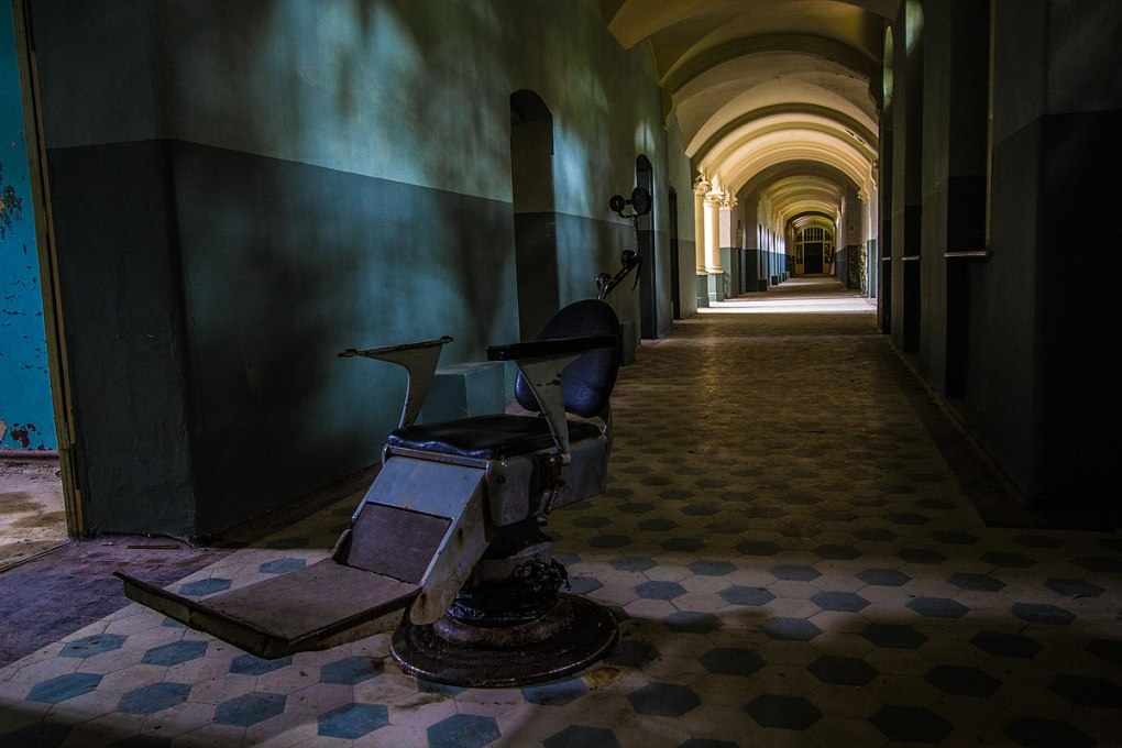 An abandoned operating chair in the middle of a corridor