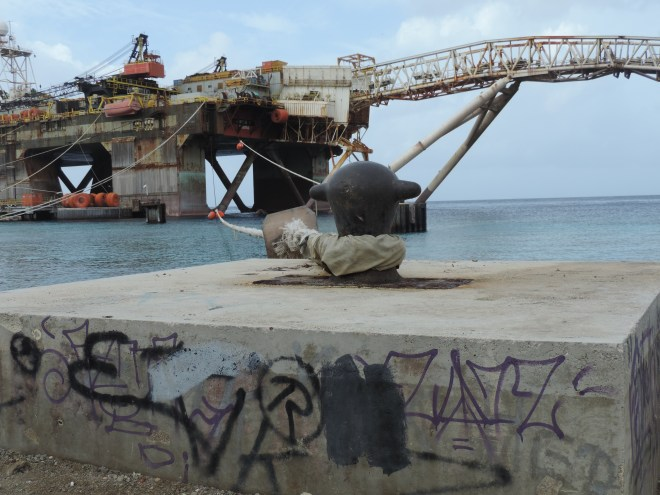 A rusty Panamanian oil platform resembling a Decepticon