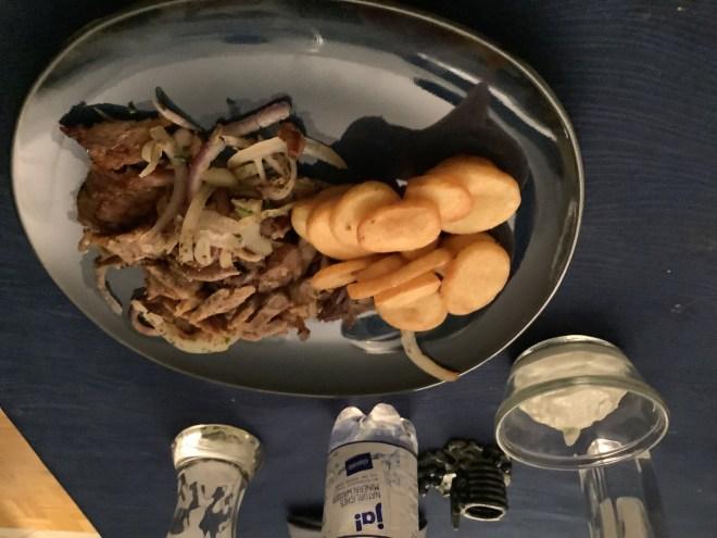 Gyros with potatoes and t'zatziki.