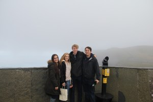 Myself, Laura, Matt, and Chris all attempting to stay dry in the Irish mist - Cliffs of Moher, Ireland