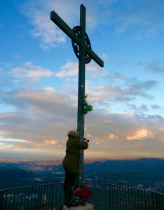 Here I am, clinging to a cross on the mountaintop hoping I don't get blown away by 60 mile per hour winds - Montserrat, Spain