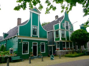 The green buildings are so quaint and beautiful - Zaanse Schans, Netherlands
