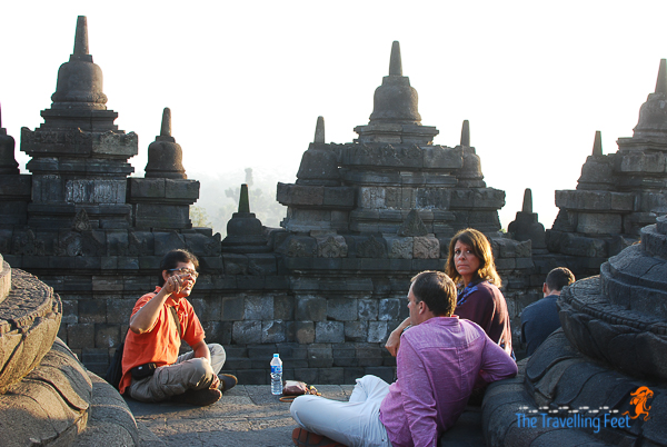 a local tour guide talking to tourists in borobudur