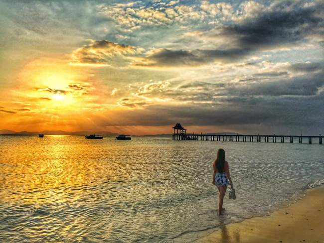 Sunset walk along the beach at Santhiya Koh Yao Yai