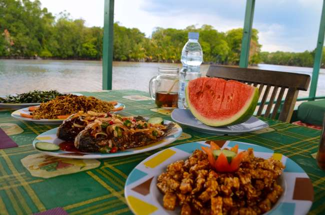 Lunch spread onboard kelotok with Orangutan Applause in Tanjung Puting national park, Borneo, Indonesia