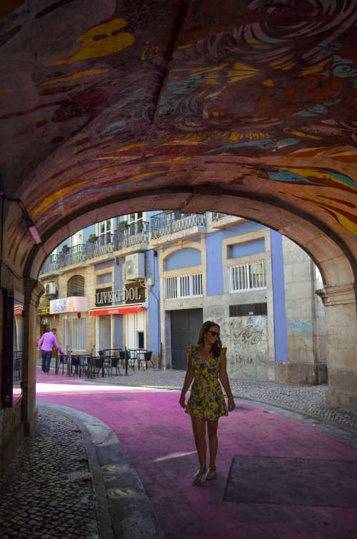 Pink street and street art in Lisbon, Portugal