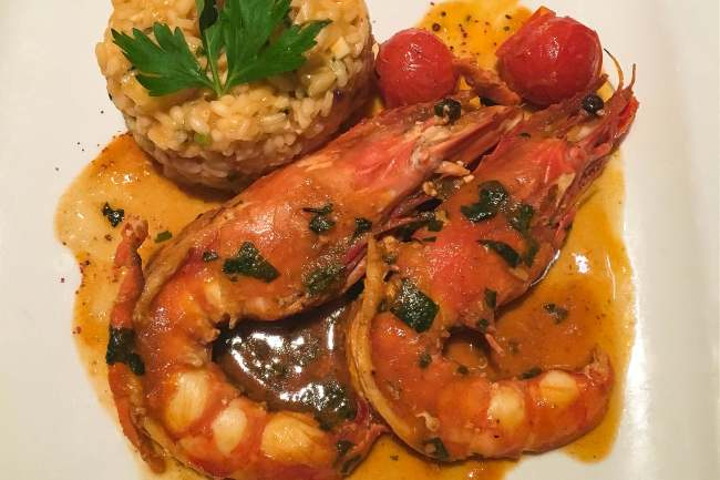 Flambeed tiger prawns with lobster risotto at Lisboa a Noité in Lisbon, Portugal