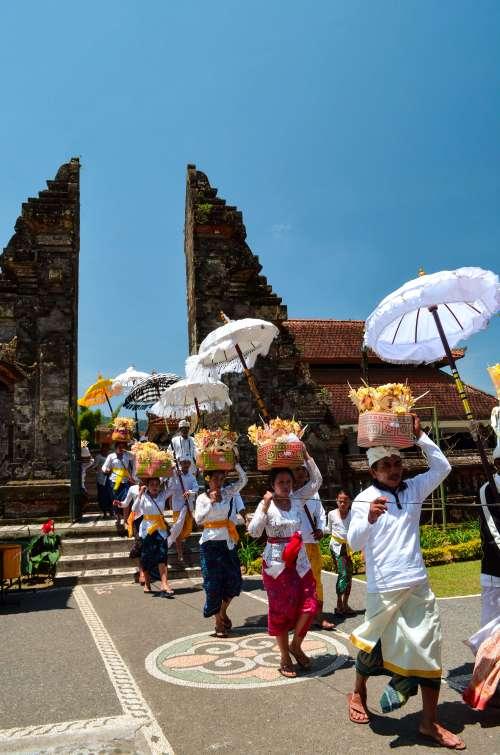 Bali Golden Tour - Ceremonial procession at Ulun Danu Beratan temple in Northern Bali, Indonesia