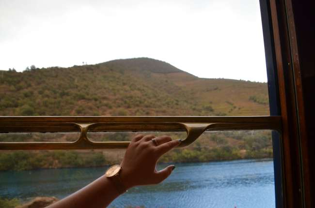 Watching the Douro valley pass by onboard The Presidential gourmet food train, Porto, Portugal