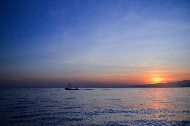 Bali Golden Tour - sunrise at Lovina beach in Northern Bali, Indonesia