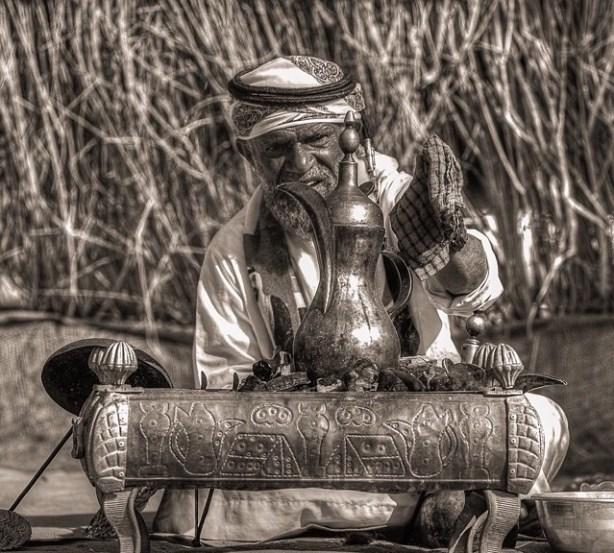 Arabic man serving coffee