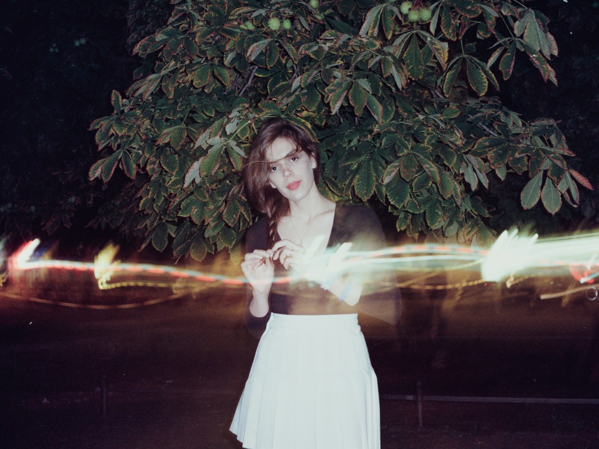 Julie Byrne at night with refracted light