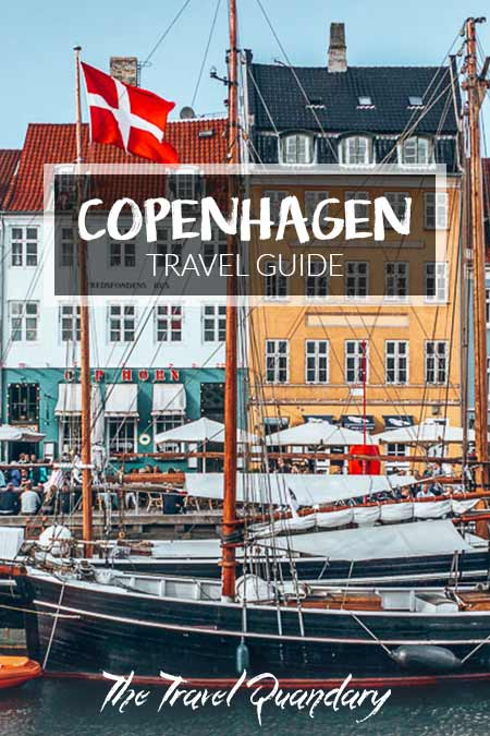 Pin to Pinterest: A boat on the colourful Nyhavn canal in Copenhagen, Denmark