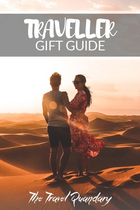 Pin to Pinterest: A couple enjoying the sunset over the dunes of the Sahara Desert, Morocco