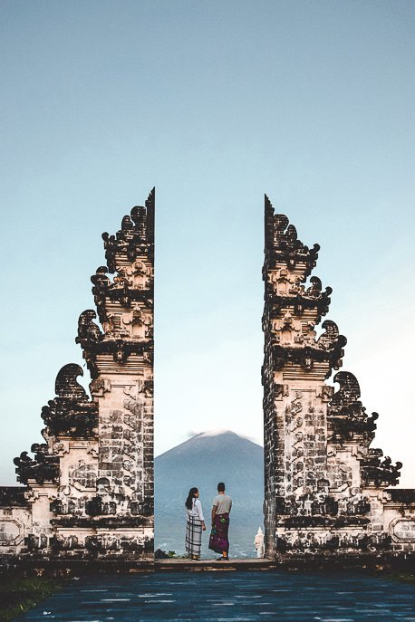 Jasmine and Bevan watching sunrise over Mount Ajung at the gates of Temple of Lempuyang Lehur, Bali Gallery