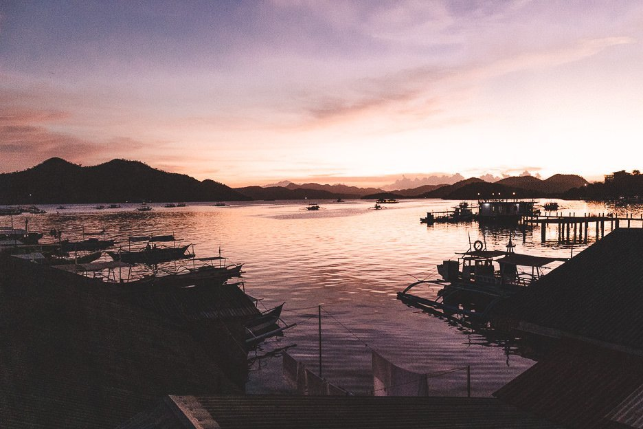 Beautiful pink and orange sunset over the harbour of Coron